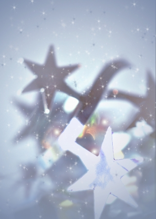 Tinsel stars in a whirl of snowflakes form a delicate frosty background with soft focus  Stock Photo
