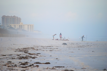 Tourists who want a beach vacation are not deterred by a little winter fog   January in Pensacola Beach, Florida, USA