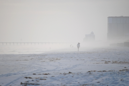 Tourists who want a beach vacation are not deterred by a little winter fog   January in Pensacola Beach, Florida, USA  Stock Photo - 17594026