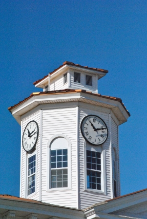 feature: Cupola with clock faces, a popular architectural feature of civic buildings in the 1800s  Stock Photo