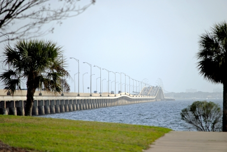 Pensacola Bay Bridge stretches three miles across the bay to join the city of Pensacola to Gulf Breeze in Florida, USA, carrying four lanes of US Highway 98