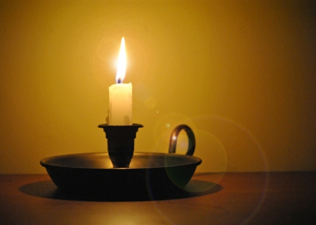 candle holder: White candle in an old-fashioned candlestick holder