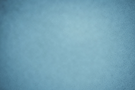 Sky blue background with subtle texture and vignette