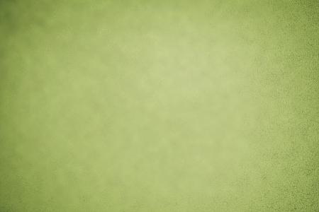Olive green background with subtle texture and vignette Banco de Imagens