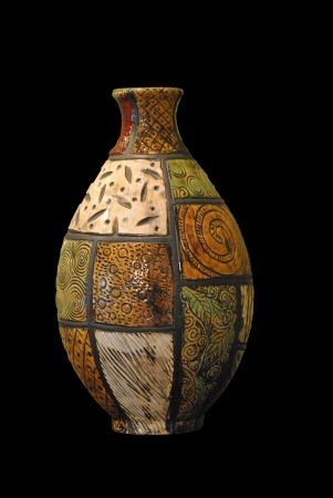 inscribed: Pottery jug with inscribed design motifs   Isolated on black  Stock Photo