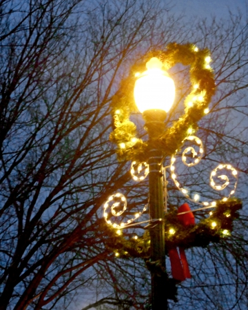 lamppost: City lamppost decorated with wreath for the Christmas holidays