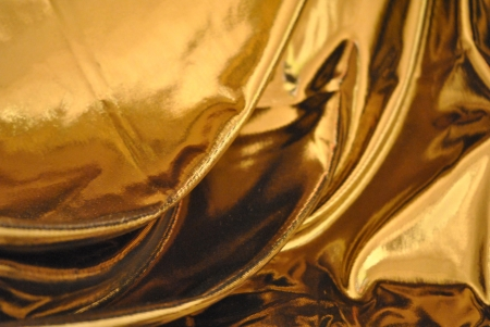 Gold lame cloth drapery background