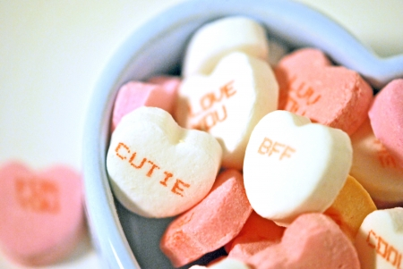 Valentine candy hearts with messages in a blue ceramic box