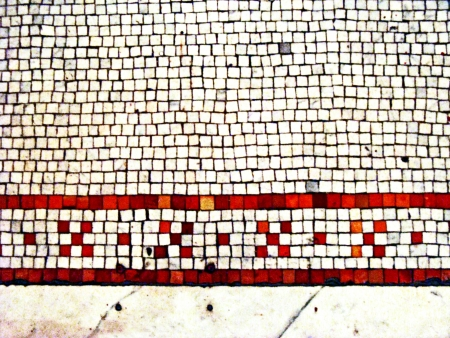 old stone tile floor with mosaic inlay pattern in red and white; vintage 1800s Stock Photo