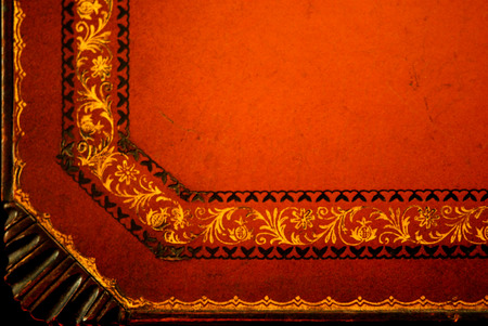 Distressed tooled leather tabletop corner