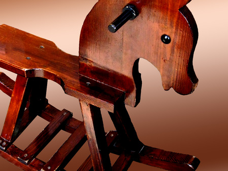 objects: Wooden rocking horse on a gradient background.