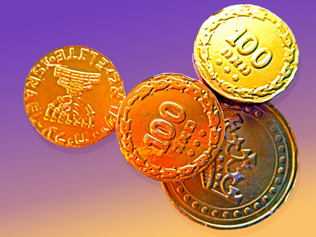 gelt: Hanukkah gelt; chocolate coins wrapped in foil. Stock Photo