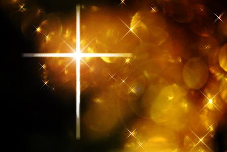 The cross of Christ against golden bokeh lights