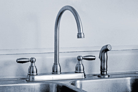 spout: Kitchen sink faucets with high arched spout and spray attachment.