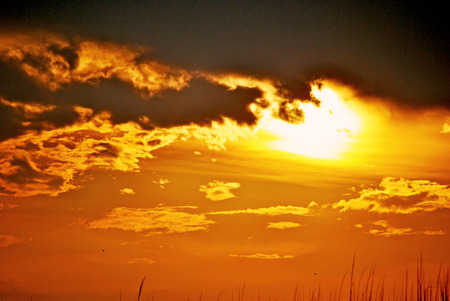 beneath: Sunset beneath storm clouds
