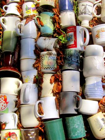 repurpose: Mugs displayed at a yard sale