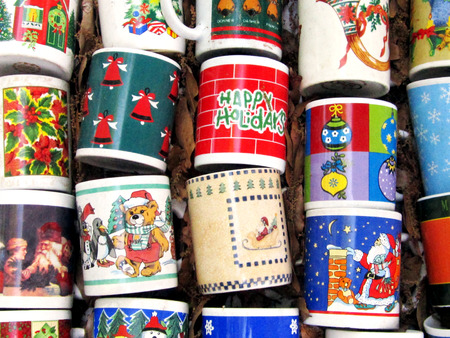 repurpose: Christmas mugs arranged on the lawn at a yard sale