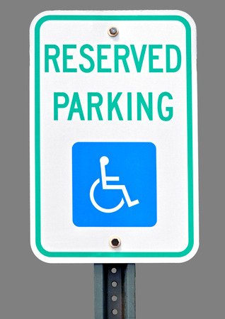 handicap sign: Sign for handicap parking accommodation. Stock Photo