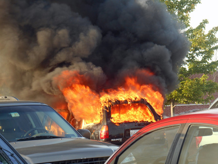 car fire in the parking lot Stock Photo