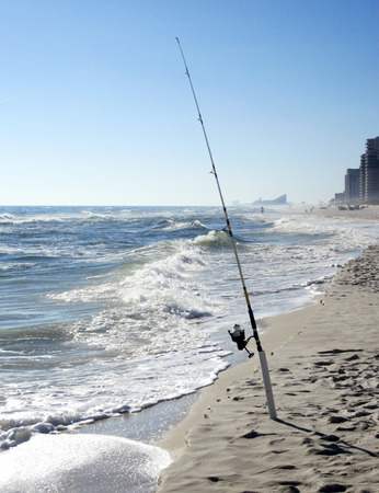 pensacola beach: Fishing pole on the beach at Pensacola Beach Florida Stock Photo