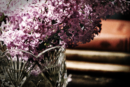 lilacs: A vase of lilacs with lowkey and film grain effects.