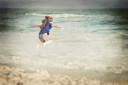 Child playing in surf. Vintage effect. Stock fotó