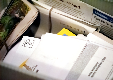 bundle of letters: A large box full of mail.