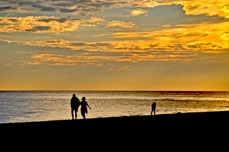 restful: A walk on the beach at sunset Stock Photo