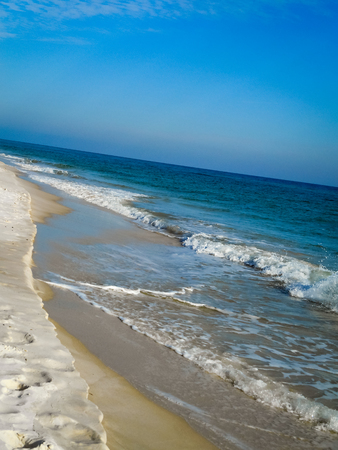 gulf of mexico: Frothy white waves on the blue Gulf of Mexico