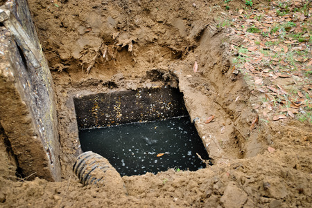 Full septic tank requires draining Stock Photo - 56409960