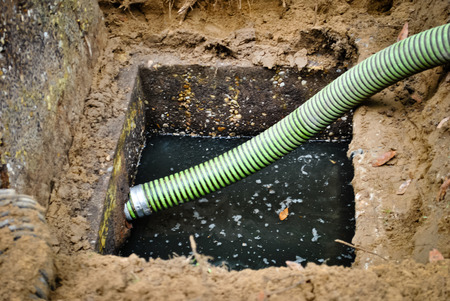 Suction hose ready to drain the septic tank Stock Photo