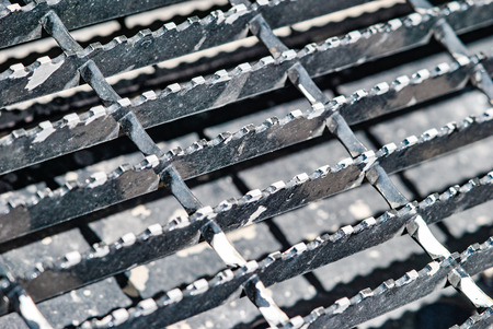 metal grate: Metal grate with ridges for secure footing