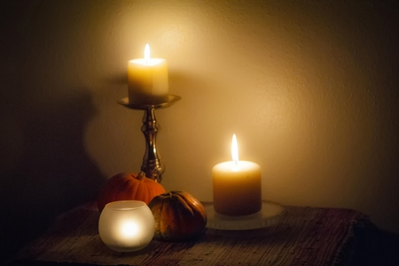 Autumn arrangement of candles and squash.