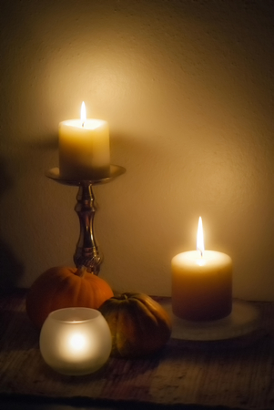 autumn arrangement: Autumn arrangement of candles and squash.