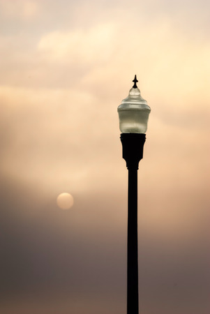 Dawn twilight--two lights, lamplight and rising sun.