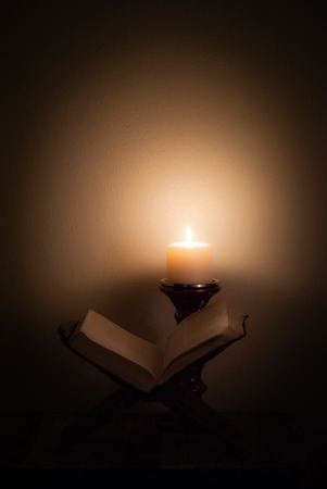 Bible in candlelight.