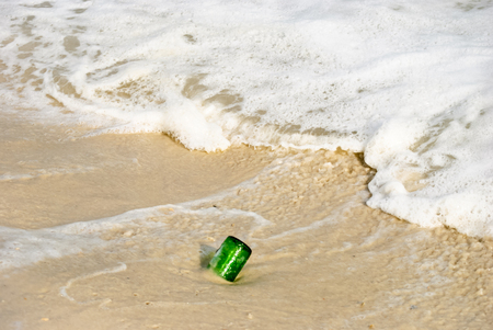 wrack: Bottle washed up on the sandy shore Stock Photo