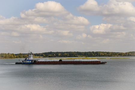 Towboat pushing barges on the Tennessee River. Editorial