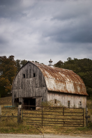 old barn: Old barn on a hillside Stock Photo