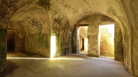 A sunbeam gleams in an arched room of Fort Pickens, part of the Gulf Islands National Seashore. Stock Photo