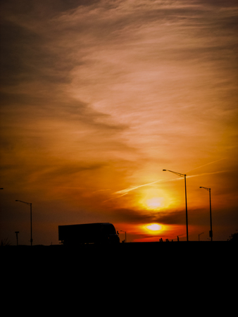 Truck driving off into the sunset.