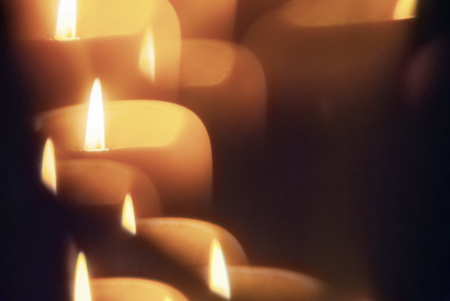 Candle flame seen through faceted crystal. Stock Photo