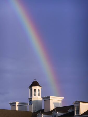 Rainbow over city hall Stock Photo