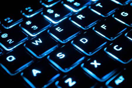 Illuminated computer keyboard closeup Stock Photo
