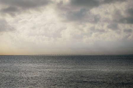 Cloudy morning sunrise view across Pensacola Bay toward Garçon Point bridge. Stock Photo