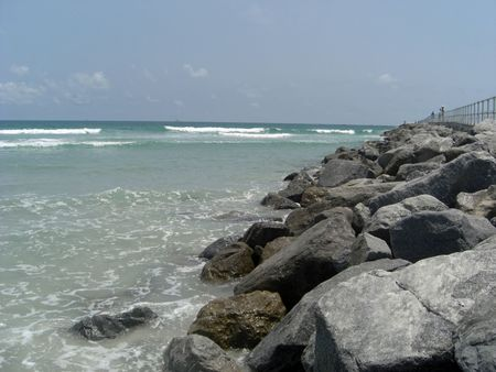 purposely: These huge bolders are lined purposely to separate the ocean in Ponce Inlet, FL.