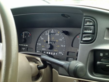 A speedometer on a dashboard of a moving car reads 39 miles. Stock Photo - 3274981