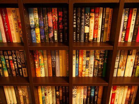 A wooden bookshelf seen diagonally from above