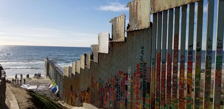 Tijuana, B.C., Mexico, February 24, 2019 - Border wall between Mexico and the U.S.A. at Playas de Tijuana, showing the beach and steel wall dividing both countries.
