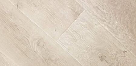 Texture for light wood laminate or vinyl floor tiles in beige color, showing wood grain imitation texture.